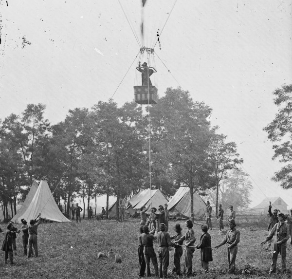 Standing in the basket of his balloon &quotIntrepid,&quot Professor Thaddeus S.C. Lowe observes the battle of Seven Pines, Va. as his balloon ascends from Lowe's base at nearby Fair Oaks on May 31, 1862. The soldiers holding the tether ropes are likely from the 4th Maine Infantry, which had assigned a detachment to assist Lowe at this particular location. One 4th Maine soldier, Joseph Wilson of Belfast, later described what Lowe and his balloon did the next day, June 1, as the Battle of Seven Pines continued. The 4th Maine detachment definitely assisted Lowe with his multiple June 1 flights.