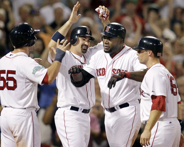 Boston Red Sox's David Ortiz celebrates his grand slam with Ryan Kalish (55), Adrian Gonzalez and Daniel Nava (66), who all scored during the fourth inning of an interleague baseball game against the Miami Marlins at Fenway Park in Boston on Wednesday, June 20, 2012.