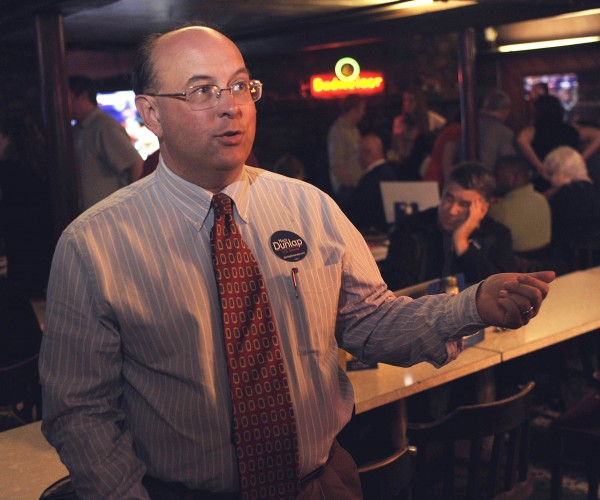 Democratic candidate Matt Dunlap speaks with supporters at his primary night headquarters at Pat's Pizza in Orono on Tuesday evening, June 12, 2012.