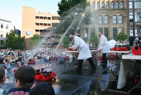 The Coke and Mentos guys, Fritz Grobe (left) joined by Steven Voltz (right) perform their Extreme Diet Coke and Mentos Experiments on Thursday, June 28, 2012 in Monument Square in Portland. The performance involved over 100 bottles of soda and over 600 Mentos candies.