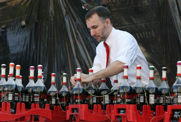 Fritz Grobe, one of the Coke and Mentos guys, prepares for a live version of their Extreme Diet Coke and Mentos Experiments on Thursday, June 28, 2012 in Monument Square in Portland.