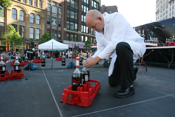Steven Voltz, one of the Coke and Mentos guys, prepares for a live version of their Extreme Diet Coke and Mentos Experiments on Thursday, June 28, 2012 in Monument Square in Portland. The performance involved over 100 bottles of soda and over 600 Mentos candies.