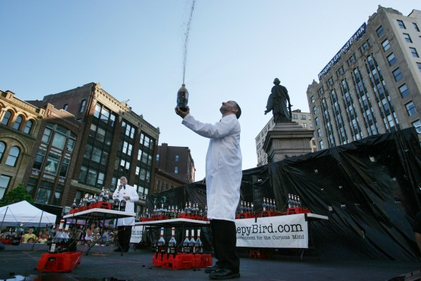 Fritz Grobe, one of the Coke and Mentos guys, prepares for a live version of their Extreme Diet Coke and Mentos Experiments on Thursday, June 28, 2012 in Monument Square in Portland. The performance involved over 100 bottles of soda and over 600 Mentos candies.