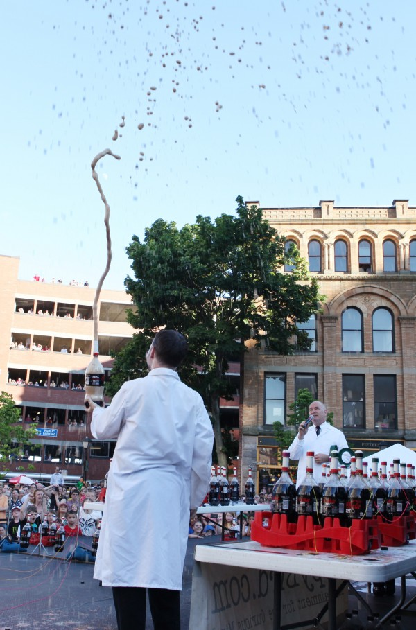 The Coke and Mentos guys, Fritz Grobe (left) joined by Steven Voltz (right) sprays soda in the air as he does a demonstration before the start of the Extreme Diet Coke and Mentos Experiments on Thursday, June 28, 2012 in Monument Square in Portland. The performance involved over 100 bottles of soda and over 600 Mentos candies.