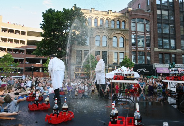 The Coke and Mentos guys, Fritz Grobe (left) and Steven Voltz (right), perform their Extreme Diet Coke and Mentos Experiments on Thursday, June 28, 2012 in Monument Square in Portland. The performance involved over 100 bottles of soda and over 600 Mentos candies.