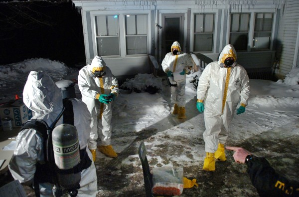 Agents with the Maine Drug Enforcement Agency remove and document evidence at 1237 State St. in Veazie on Thursday, Feb. 28, 2008, where the ingredients for manufacturing methamphetamine were discovered.