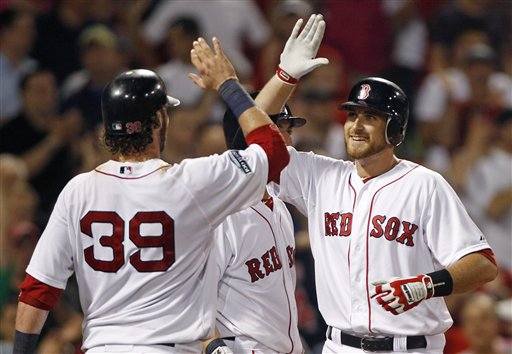 Boston Red Sox Will Middlebrooks, right, is congratulated by Jarrod Saltalamacchia (39) after his two-run home run against the Miami Marlins during the eighth inning of a baseball game at Fenway Park in Boston, Thursday, June 21, 2012.