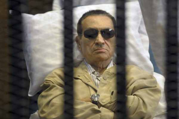 In this Saturday, June 2, 2012 file photo, Egypt's ex-President Hosni Mubarak lays on a gurney inside a barred cage in the police academy courthouse in Cairo, Egypt.
