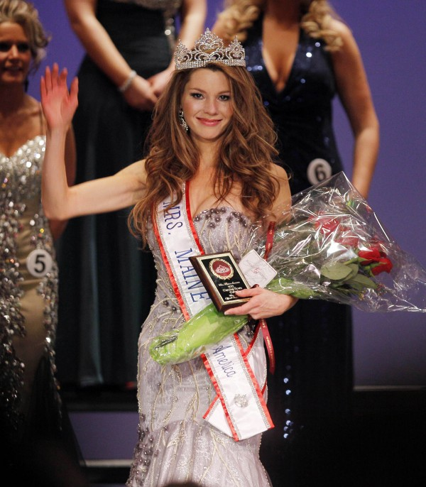 Cassandra Provencher acknowledges the applause after winning the Mrs. Maine-America Pageant in February 2011, in Saco.