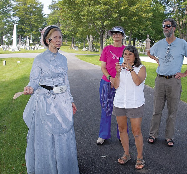 Dressed in period garb, Dana Lippitt of the Bangor Museum and History Center speaks to visitors participating in a Mount Hope Cemetery Tour sponsored by the BMHC. Five such tours are scheduled this summer.