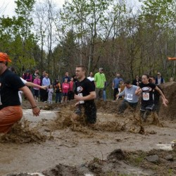 Contestants plow through a puddle in the University of Southern Maine's 2012 Into the Mud Challenge in Gorham, Maine, May 5, 2012. (Photo courtesy USM)