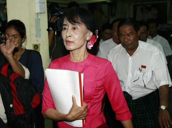 Myanmar opposition leader Aung San Suu Kyi arrives to attend a press conference at the headquarters of her National League for Democracy party in Yangon, Wednesday, June 6, 2012. A state-run newspaper called Suu Kyi and President Thein Sein &quotthe hope of Myanmar&quot — rare praise for the opposition leader that was tempered with worry that possible tensions between the two reform-minded politicians could derail changes in the long-oppressed country.