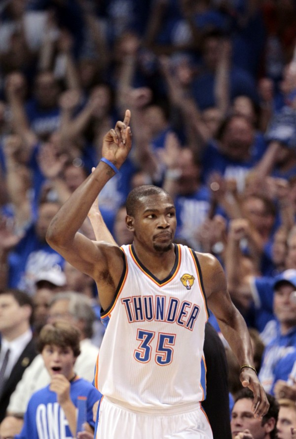 Oklahoma City Thunder small forward Kevin Durant (35) gestures as he goes down court against the Miami Heat during the second half at Game 1 of the NBA finals series, Tuesday, June 12, 2012, in Oklahoma City. The Thunder won 105-94.