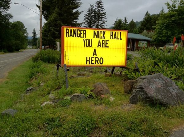 A roadside tribute sign for park ranger Nick Hall, who lost his life while taking part in a rescue effort on Mount Rainier in Washington Thursday, June 21, 2012.