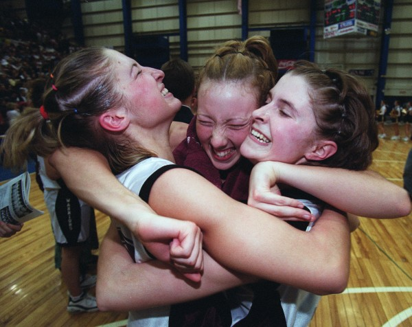 Nokomis players Michelle Murray (from left), Sara Lowe and Lindsey Welch embrace seconds after winning the Warriors' first Class A state championship in 2001.