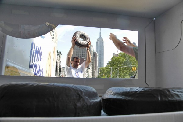 Two giant doughnuts remain inside a box as Entenmann's baker Augusto Cunha is directed to lift one of the custom-made doughnuts for a photo, marking the 75th annual National Donut Day on Friday, June 1, 2012 during a celebration in Madison Square Park, New York. Entenmann's displayed the giant doughnuts, each one foot in diameter, in the &quotlargest box of doughnuts ever created,&quot as stated in a press release.