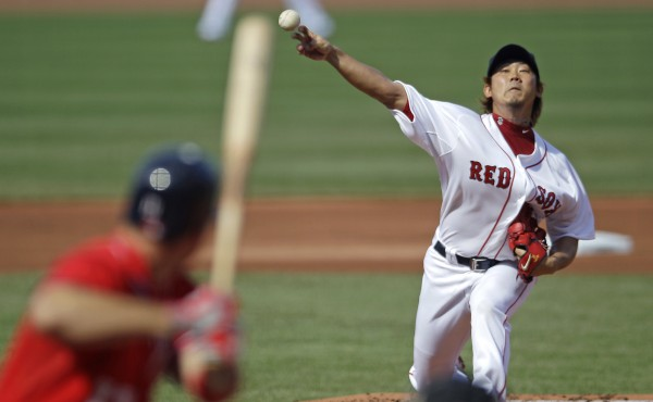 Boston Red Sox starter Daisuke Matsuzaka delivers to Washington Nationals' Ryan Zimmerman during the first inning of a baseball game at Fenway Park, Saturday, June 9, 2012, in Boston. Matsusazka, who underwent Tommy John surgery a year ago, made his first start of the year in the majors.