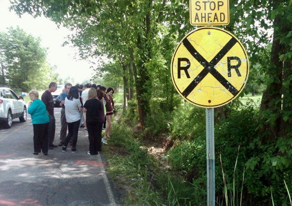 People gather at the scene of an early morning crash on Boston Road in Lorain County, Ohio, to pay their respects and mourn three teens who died there Sunday, June 3, 2012.