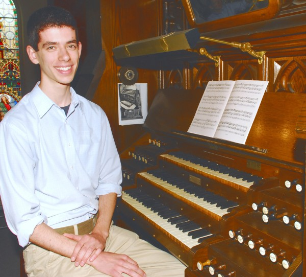 Abraham Ross won the 2012 scholarship from the College of the Holy Cross in Worcester, Mass., to study the organ. The college gives out one scholarship a year. He is pictured sitting next to the organ at St. John Catholic Church in Bangor Wednesday, June 6, 2012.