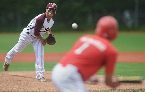 Orono High School's Dom Mowrer pitches to Dexter High School's Matt Crane who prepares to bunt in the third inning of the Eastern Maine Class C baseball semifinal at Mahaney Diamond in Orono Saturday, June 9, 2012.