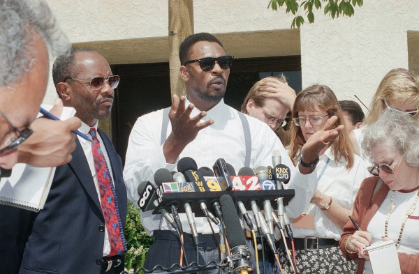 Rodney King speaks at a news conference in Santa Ana, Calif. along with his attorney Milton Grimes (left) in June 1994. King, the black motorist whose 1991 videotaped beating by Los Angeles police officers was the touchstone for one of the most destructive race riots in the nation's history, has died, his publicist said Sunday, June 17, 2012. He was 47.