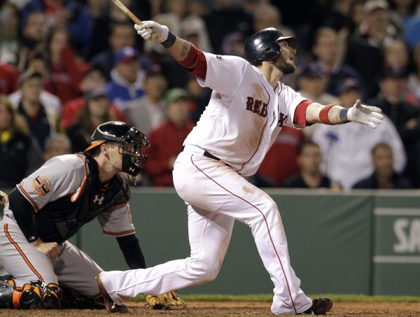 Boston Red Sox's Jarrod Saltalamacchia follows through on a two-run home run to send the baseball game into extra innings, as Baltimore Orioles catcher Matt Wieters watches during the ninth inning at Fenway Park in Boston on Tuesday, June 5, 2012. The Orioles won 8-6.