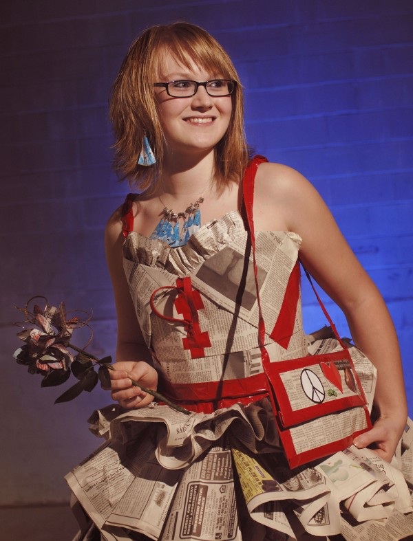 Hannah Wigham and her grandmother have made a dress out of newspapers. The dress, which sports matching purse and glossy shoes, is a creation for Sarah's eighth-grade semiformal dance at Dexter Middle School.