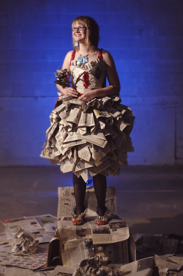 Hannah Wigham, 13, and her grandmother Patricia Brawn have made a dress out of newspapers. The dress is a creation for Sarah's eighth grade semiformal dance at Dexter Middle School.