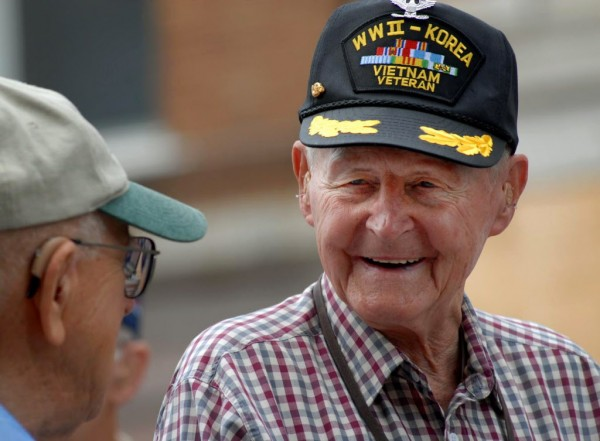 Lester Slate (right), 85-year-old Navy veteran, chats with friend Henry Stupakewicz, 87-year-old Army veteran, as the Memorial Day parade forms on Exchange Street in 2008.