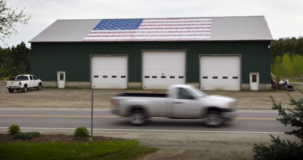 A flag on the roof of the E. C. Boynton & Sons Trucking Co. in Prospect has faded after 10 years. The flag, which was painted in response to the 9/11 terrorist attacks, will be repainted this summer.