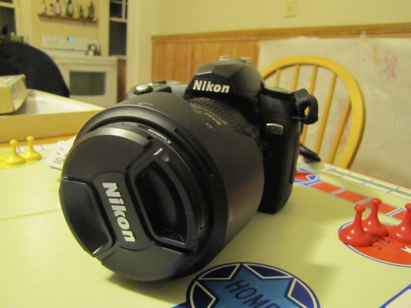 This Nikon D70 camera was given to Miriam Kates-Goldman as part of a pay it forward story that obligates her to help someone and to pass on a story that originated in the 1940s.