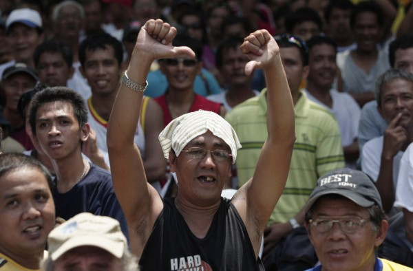A Filipino fan gestures after hearing the decision in a match between Filipino boxing hero Manny Pacquiao and American boxer Timothy Bradley at a free live public viewing at a park in Marikina, east of Manila, Philippines, Sunday June 10, 2012.