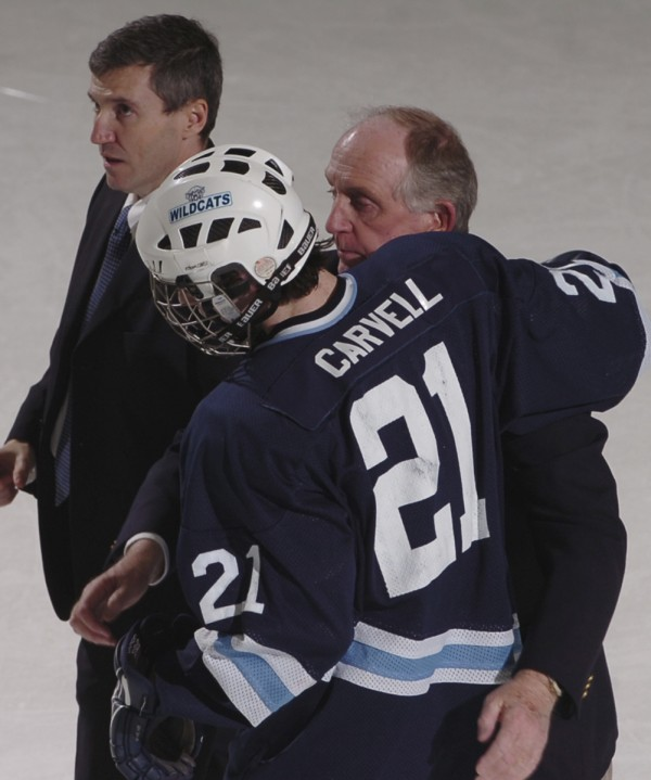 Senior Mark Carvell of Presque Isle hugs Wildcats' assistant coach John Haley as the join head coach Dr. Carl Flynn after the Class B hockey state final in 2009.