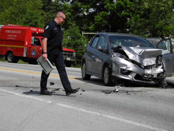 A Hancock County Sheriff's Office accident investigator surveys the scene of a fatal crash on Route 1, near the intersection with Route 175 on June 9, 2012. One person died in the two-car collision that was reported at 12:50 p.m.