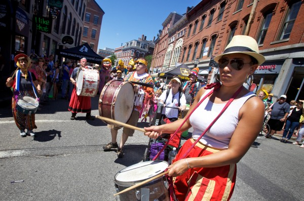 Zara Machatine of the Shoestring Theatre leads a drum corps in Portland Sunday, June 10, 2012, during a parade at the 39th annual Old Port Festival.