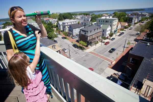 Stephanie Davis and daughter Lilia, 5, play with a toy telescope at the top of the Portland Observatory on Munjoy Hill Thursday, June 14, 2012.