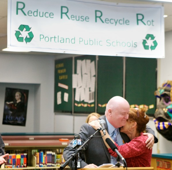 Portland Public School Superintendent James Morse gets a hug from waste reduction group member Susan Webster as he announces the end of styrofoam lunch trays at city schools Tuesday June 5, 2012. Starting in the next school year, city schools will use recyclable paper trays.