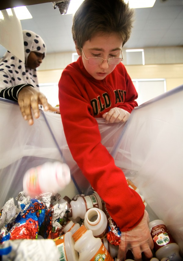 King Midddle School sixth-grader Max Tommer, 12, volunteers part of his lunch period Tuesday June 5, 2012 in Portland to sort recyclable items dropped in the wrong bins in the cafeteria. The school recycling program is reducing cafeteria trash by 50 to eighty percent.