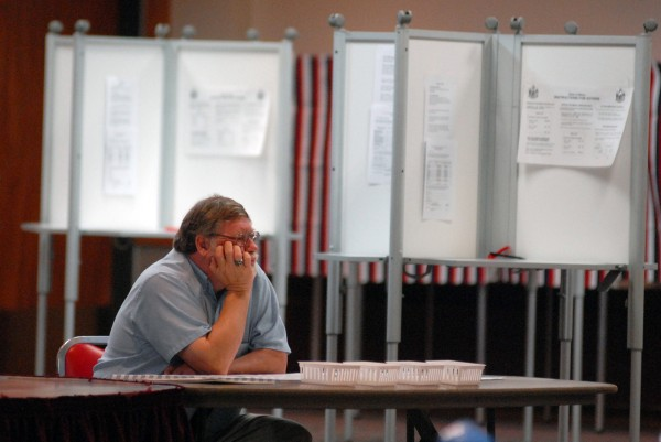 Election worker Dave Clark waits for voters to come through his line Tuesday morning at the Bangor Civic Center, as turnout was slow.  &quotIt's as expected probably,&quot said Clark. &quotIt's early. Usually around 5 p.m. it picks up.&quot