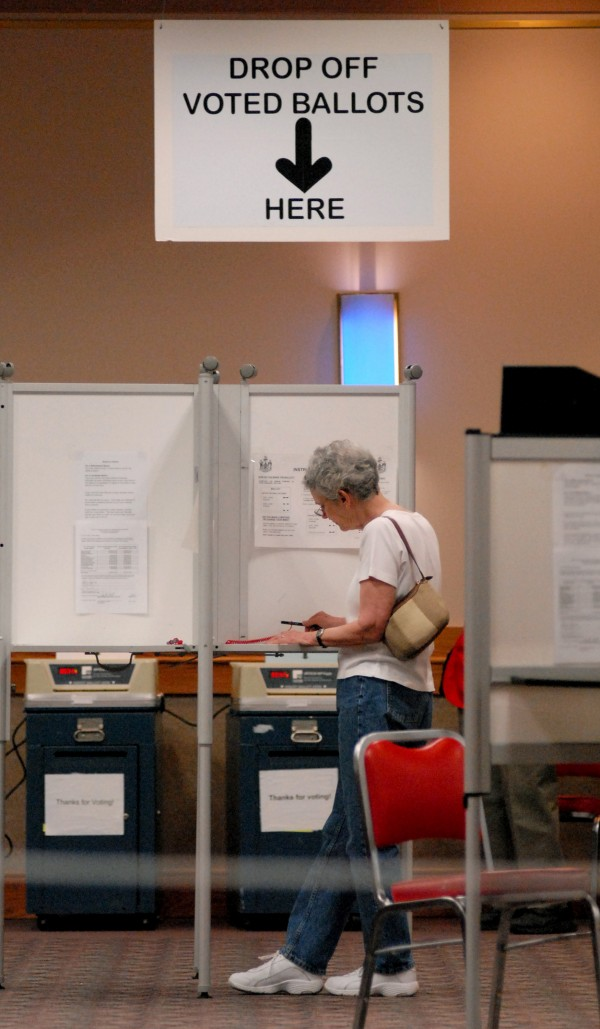 JoAnn Lancaster casts her vote Tuesday morning at the Bangor Civic Center.  &quotIt is disappointing, especially since there's a senate race,&quot Lancaster said about the low morning turnout.