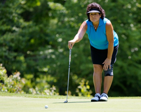 LPGA Hall of Famer Nancy Lopez lines up a put at the Falmouth Country Club Thursday June 21, 2012 during a Pro-Am round ahead of the Hannaford Community Challenge Tournament this weekend.