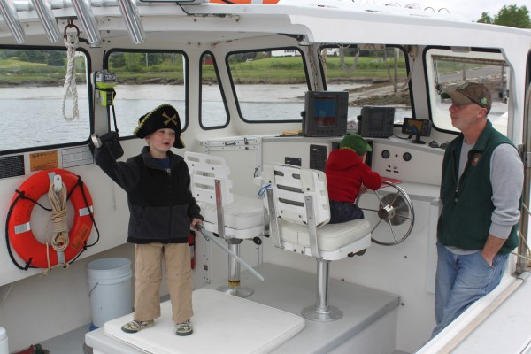 "Capt. James Robertson of Harrington sits aboard ""Kandi Leigh"" with his son McKade, 4, (left) and Brody, 2, on June 6, 2012, before embarking on a seabird cruise."