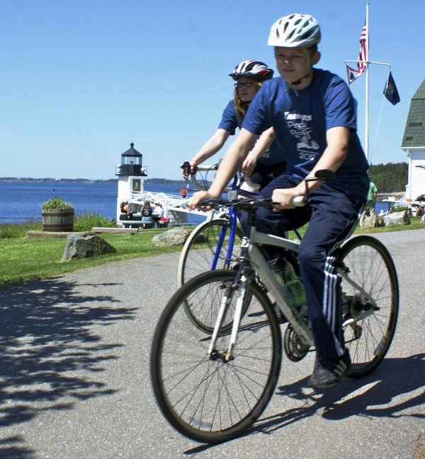 Trekkers' riders, Olivia Stone and Kalob Crute, at Marshall Point Lighthouse in Port Clyde during Pedal to the Port 2012.