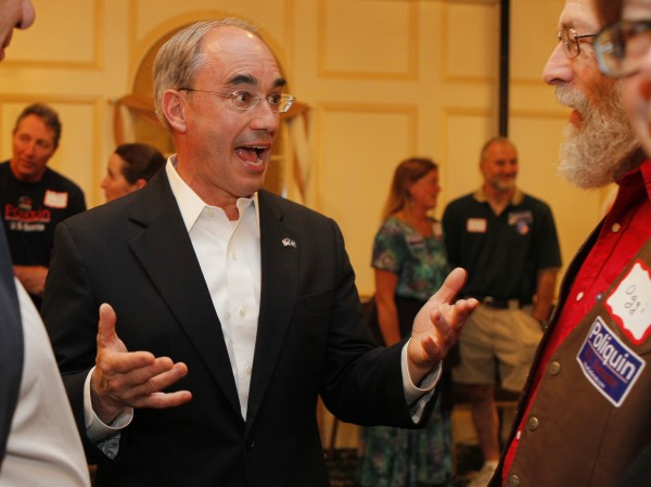Bruce Poliquin, Republican candidate for U.S. Senate, greets supporters at his election night party, Tuesday, June 12, 2012, in Augusta.