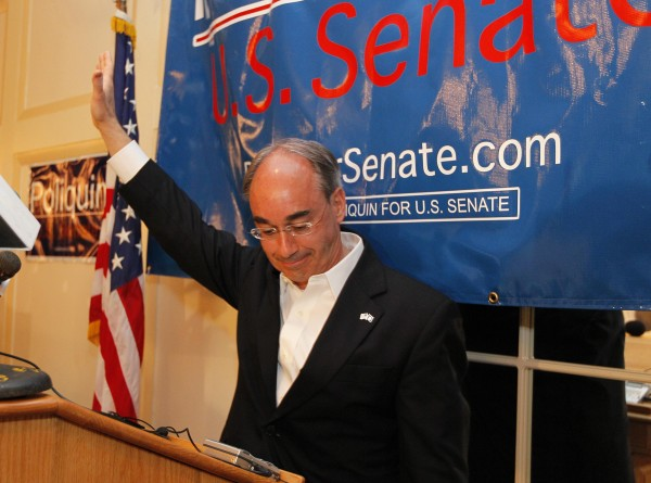 Bruce Poliquin, Republican candidate for U.S. Senate, waves after telling supporters his chances do not look good, at his election night party, Tuesday, June 12, 2012, in Augusta.
