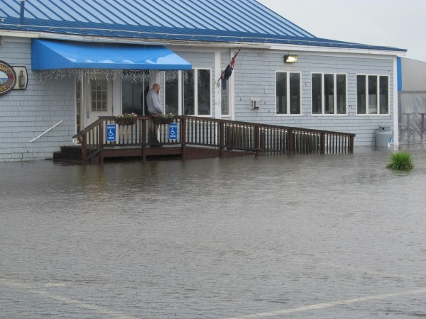 Instead of a parking lot full of cars, the lot at Kennebec Tavern was covered with water from the Kennebec River on Monday.