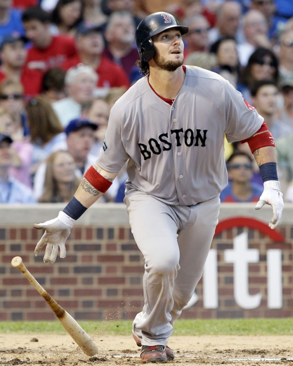 Boston Red Sox's Jarrod Saltalamacchia watches his two-run home during the fourth inning of an interleague baseball game against the Chicago Cubs in Chicago, Saturday, June 16, 2012.