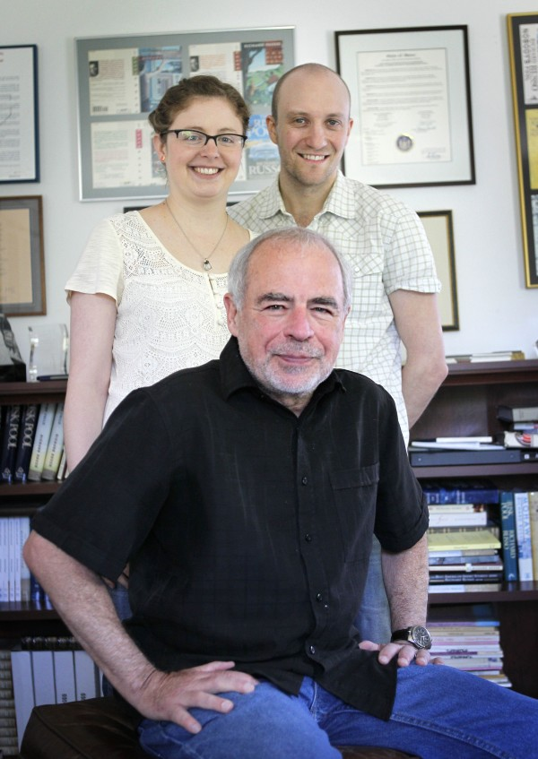Pulitzer Prize-winning novelist Richard Russo (seated), poses with his daughter, artist Kate Russo, and her husband, designer Tom Butler, at his home in Camden on Thursday, June 14, 2012. The trio collaborated on Russo's latest work.