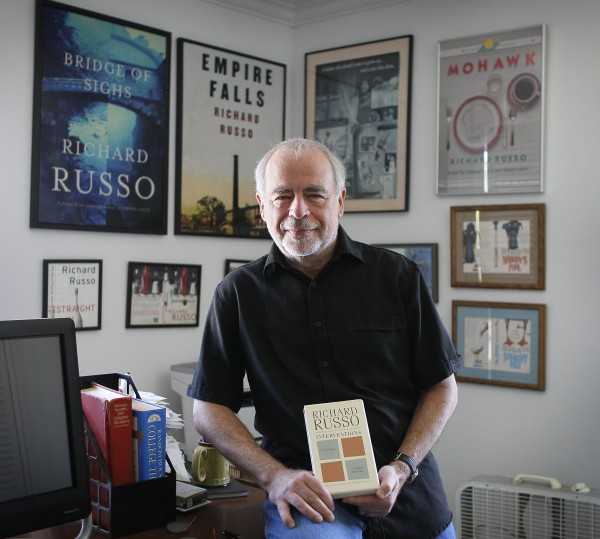 Pulitzer Prize-winning novelist Richard Russo poses with his newest work, &quotInterventions,&quot at his home in Camden on Thursday, June 14, 2012. A critic of e-books, Russo won't allow &quotInterventions&quot to be sold in electronic form.