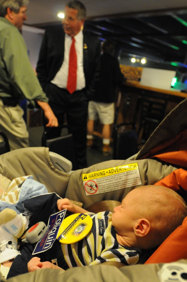 2nd District Republican candidate Blaine Richardson (center) talks with supporters while 3-week-old Max Prill of Winterport sleeps while holding a Richardson pin at Richardson's campaign party at Hero's sports bar in Bangor Tuesday evening, June 12, 2012.